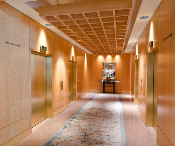 commercial building hall way with four elevators