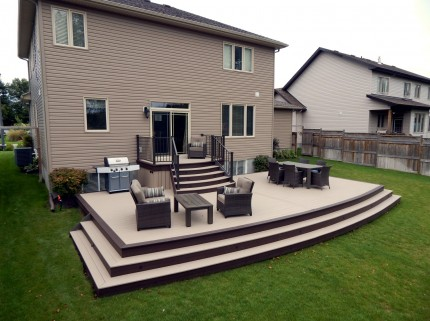 large brand new custom deck with chairs and tables in ottawa home backyard