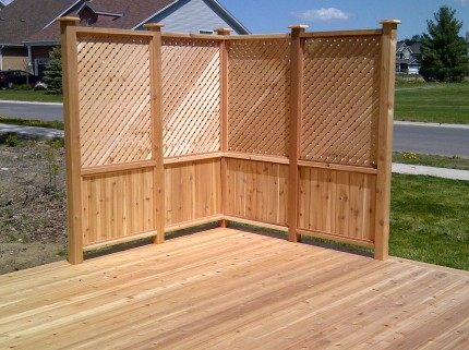 custom wooden deck with corner fence