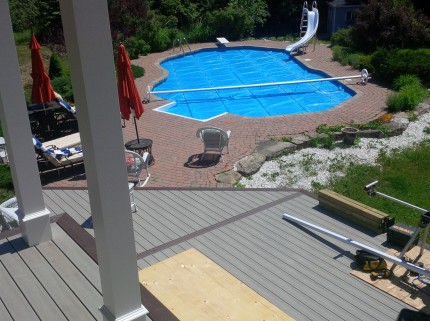 under construction custom deck overlooking ottawa backyard with pool and waterslide