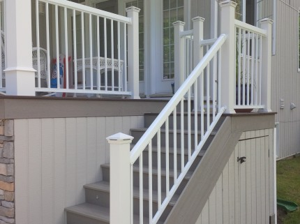 stairs with railing leading down from covered custom deck