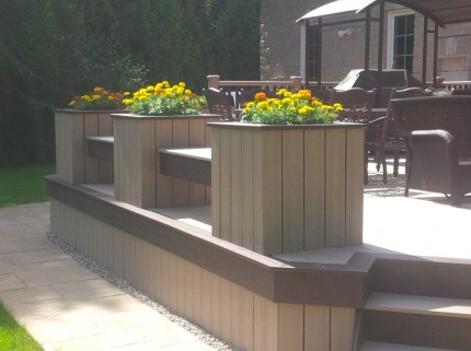 detail of low height custom deck with planters and benches around the perimeter