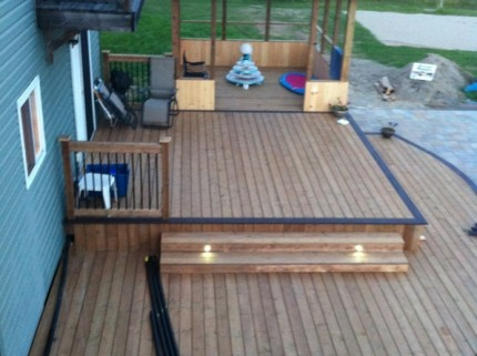 top down view of custom two level deck with pergola and lights embedded in steps