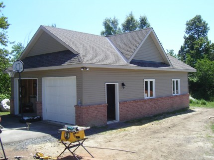 large detached two car garage with construction underway