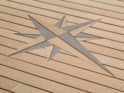 intricately embedded compass design in custom deck floor
